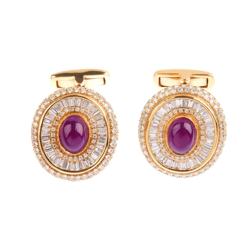 109 - A pair of ruby and diamond cufflinks. Each designed as an oval ruby cabochon, with brilliant and bag...