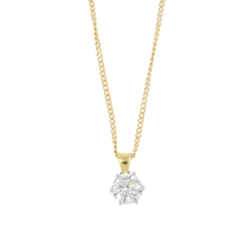 11 - A diamond single-stone pendant. The brilliant-cut diamond, suspended from a tapered surmount and cur...