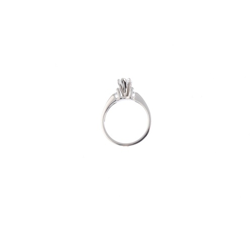 110 - A diamond ring. The heart-shape diamond, weighing 0.70ct, with brilliant-cut diamond line shoulders....