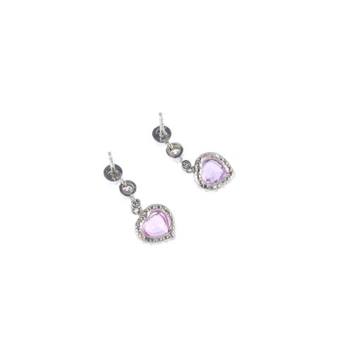 111 - A pair of sapphire and diamond earrings. Each designed as a heart-shape pink or purple sapphire with...