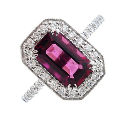 112 - An 18ct gold tourmaline and diamond cluster ring. The rectangular-shape pink tourmaline, with brilli...