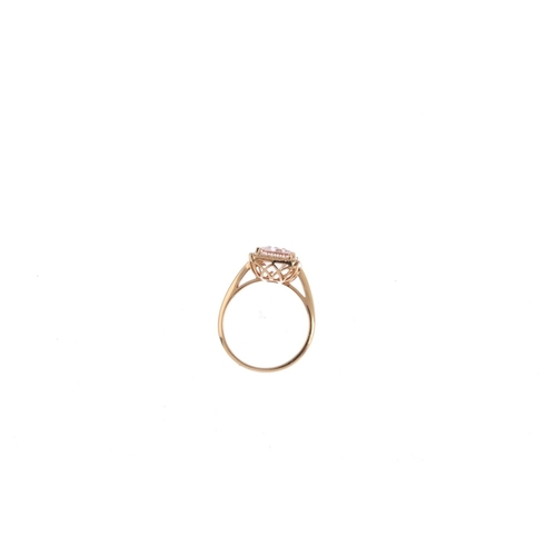 115 - An 18ct gold morganite and diamond cluster ring. The rectangular-shape morganite, with brilliant-cut...
