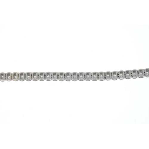 119 - A diamond line bracelet. Designed as a brilliant-cut diamond, wide partial-collet set line. Estimate...