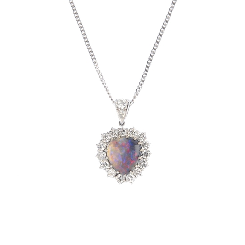 120 - An 18ct gold black opal and diamond heart pendant. The black opal cabochon, with brilliant-cut diamo...