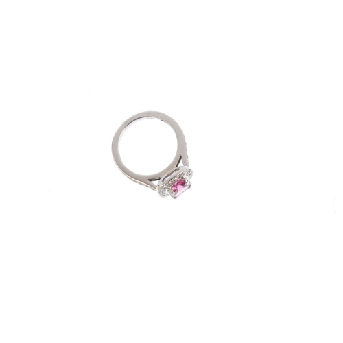 121 - An 18ct gold tourmaline and diamond ring. The cushion-shape pink tourmaline, with brilliant-cut diam...