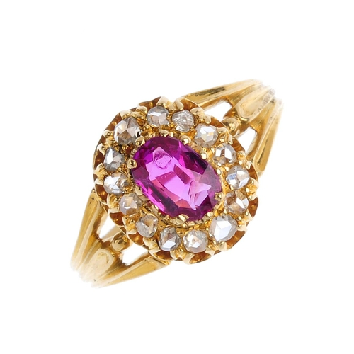 124 - A Burmese ruby and diamond cluster ring. The cushion-shape ruby, weighing 0.90ct, with rose-cut diam...