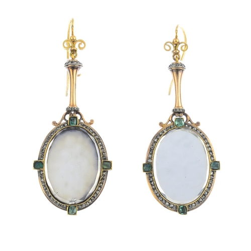125 - A pair of emerald and diamond earrings. Each designed as a hand mirror, the oval-shape bevelled mirr...