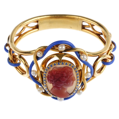 126 - A mid Victorian gold, hardstone cameo, cultured pearl and enamel hinged bangle. The agate carved to ...