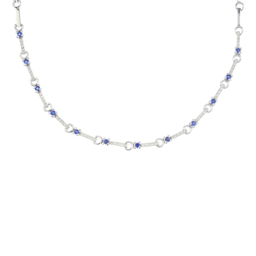 13 - An 18ct gold sapphire and diamond necklace. Designed as a series of brilliant-cut diamond bar links,...