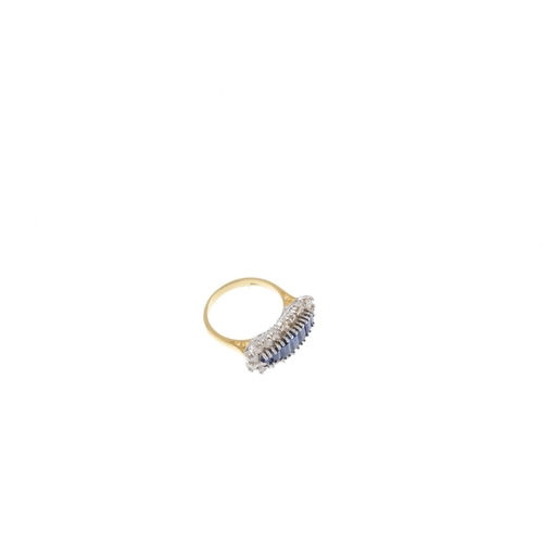 138 - An 18ct gold sapphire and diamond dress ring. Designed as a graduated rectangular-shape sapphire lin...