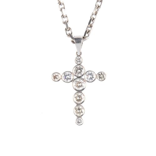 139 - An 18ct gold diamond cross pendant. The vari-size brilliant-cut diamond collet cross, with tapered s...