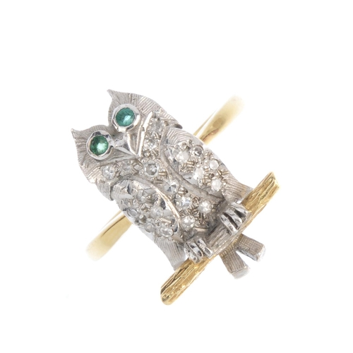14 - A diamond owl ring. The single-cut diamond owl, with circular-shape emerald eyes, perched upon a tex...