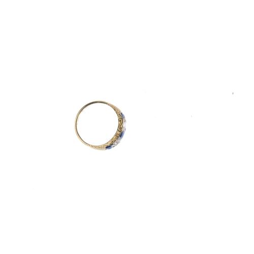 142 - A sapphire and diamond five-stone ring. The graduated circular-shape sapphire line, with vari-cut di...