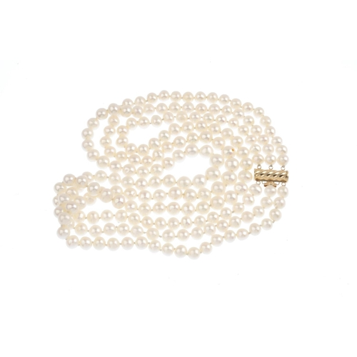 143 - A cultured pearl three-row necklace. Comprising three graduated cultured pearl strands, measuring 8....