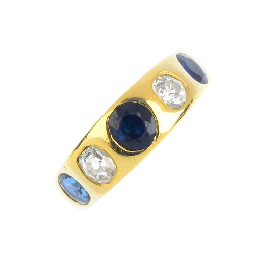 144 - A sapphire and diamond five-stone ring. The alternating oval-shape sapphire and old-cut diamond line...