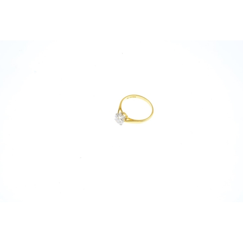 145 - An 18ct gold diamond single-stone ring. The brilliant-cut diamond, with tapered shoulders. Estimated...