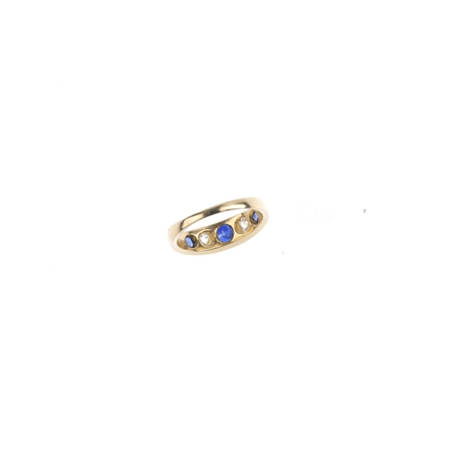 146 - An 18ct gold sapphire and diamond five-stone ring. The alternating graduated cushion-shape sapphire ...