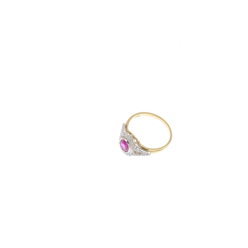 149 - An 18ct gold ruby and diamond cluster ring. The oval shape ruby, with brilliant-cut diamond scallope...
