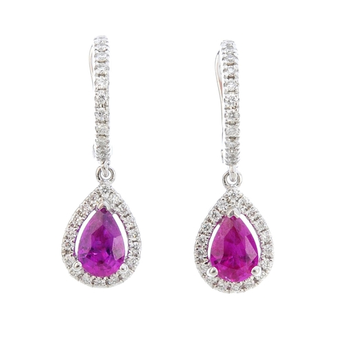 153 - A pair of 18ct gold ruby and diamond earrings. The pear-shape ruby and brilliant-cut diamond cluster...