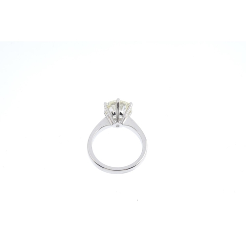 154 - An 18ct gold diamond single-stone ring. The circular-cut diamond, weighing 3.28cts, with tapered sho...