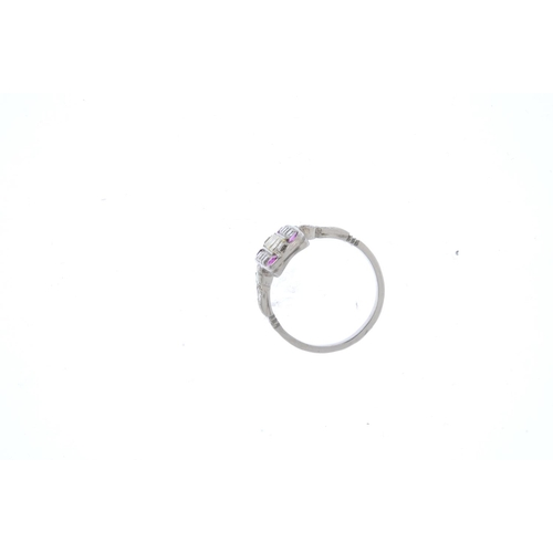 159 - A diamond, 'coloured' diamond and ruby dress ring. The square-shape diamond line, with similarly-cut...