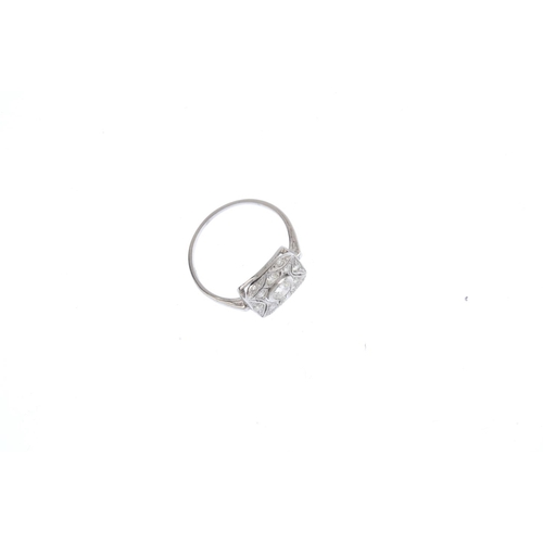 163 - A diamond dress ring. Of openwork design, the brilliant-cut diamond collet, with similarly-cut diamo...