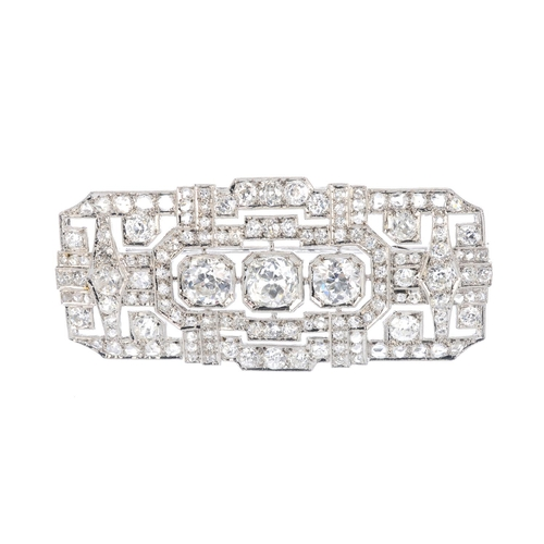 166 - A mid 20th century diamond brooch. Of openwork design, the graduated circular-cut diamond line, with...