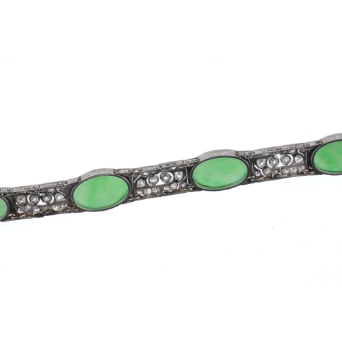 168 - A jade and diamond bracelet. Comprising a series of five oval jadeite cabochons, with brilliant and ...