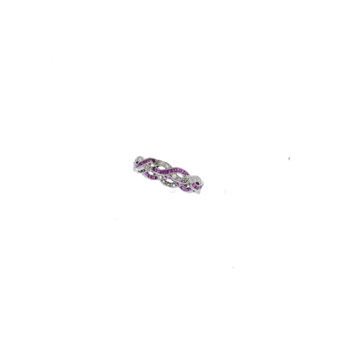 17 - A ruby and diamond full eternity ring. Designed as two pave-set diamond and square-shape ruby interw...