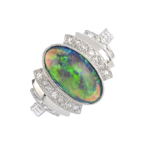 170 - A black opal and diamond dress ring. The oval black opal cabochon, with alternating single-cut diamo...