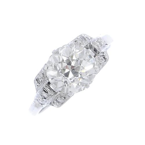 173 - A diamond single-stone ring. The circular-cut diamond, with single-cut diamond geometric sides. Prin...