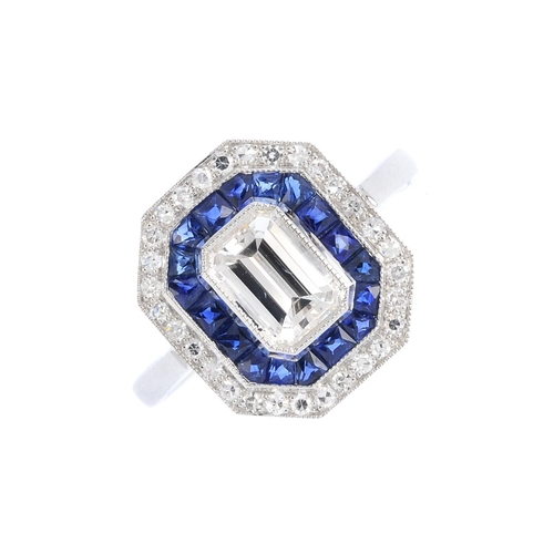 176 - A sapphire and diamond cluster ring. Of octagonal outline, the rectangular-shape diamond, within a c...