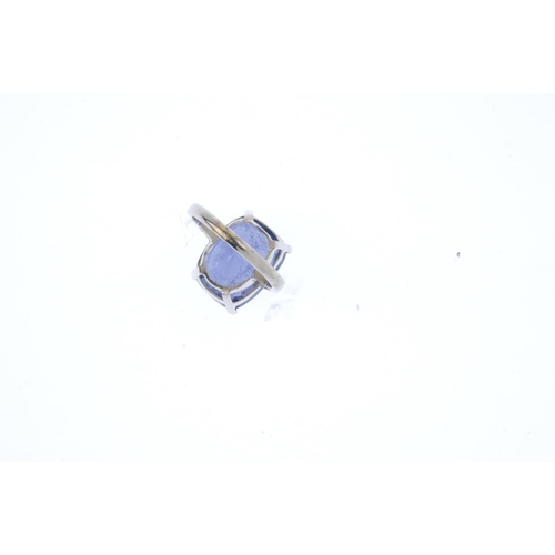 178 - A spinel single-stone ring. The cushion-shape blue spinel, weighing 15.82cts, with engraved foliate ...