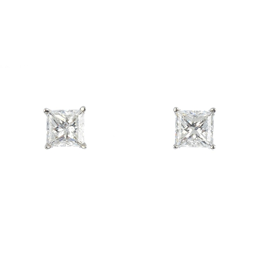181 - A pair of 18ct gold square-shape diamond stud earrings. Each laser inscribed GIA 1249463002 and GIA ...