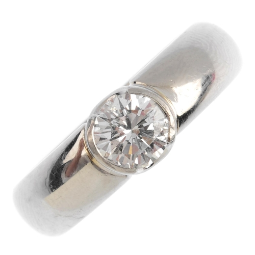 186 - A platinum diamond single-stone ring. The brilliant-cut diamond, within a partial collet setting. Es...