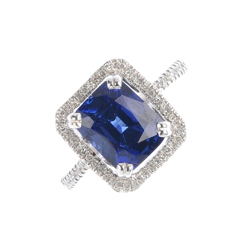 187 - A sapphire and diamond cluster ring. The rectangular-shape sapphire, with single-cut diamond surroun...
