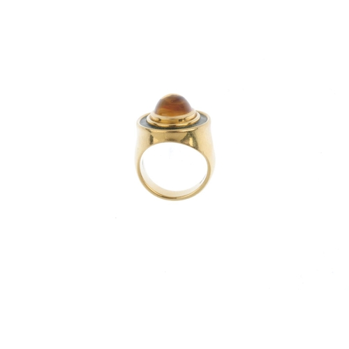 190 - DE VROOMEN - an 18ct gold citrine and enamel ring. The oval citrine cabochon, with green enamel surr...
