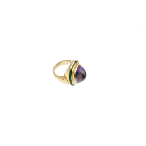 193 - DE VROOMEN - an 18ct gold amethyst and enamel ring. The oval amethyst cabochon, with green enamel su...