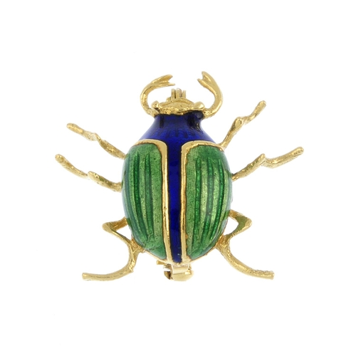 195 - A mid 20th century enamel stag beetle brooch. The stag beetle with green enamel wings and blue ename...