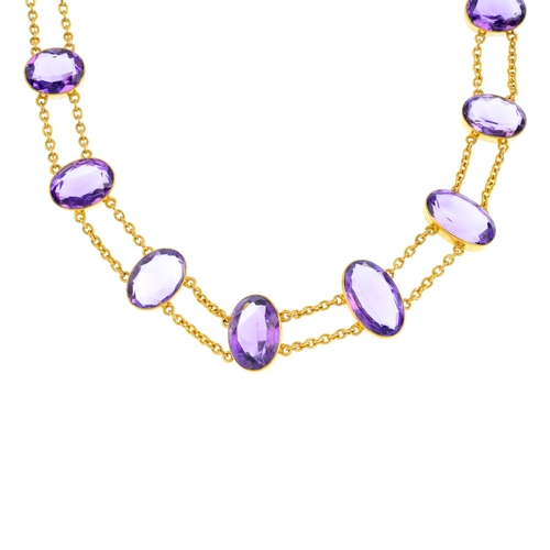 196 - An amethyst necklace. Designed as a graduated oval-shape amethyst collet line, with curb-link chain ...