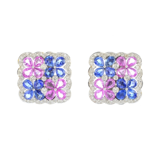 2 - A pair of sapphire and diamond earrings. Each designed as an alternate sapphire and pink sapphire fl...