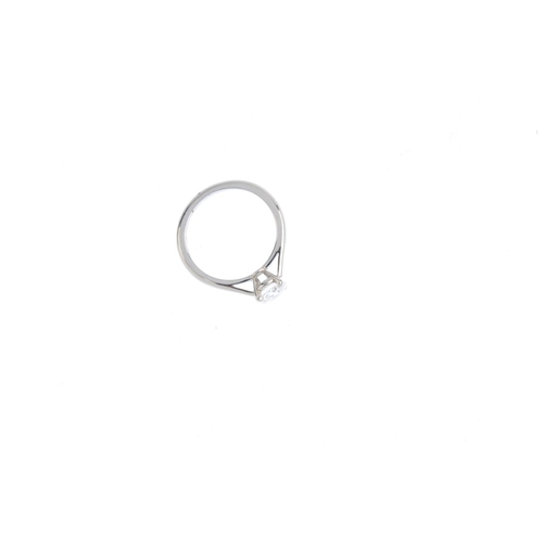 200 - CARTIER - a platinum diamond single-stone ring. The brilliant-cut diamond, weighing 0.90ct, with tap...