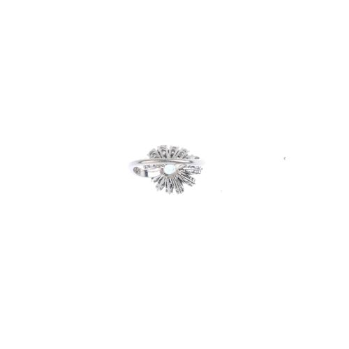 202 - An aquamarine and diamond ring. The octagonal-shape aquamarine, with brilliant and baguette-cut diam...