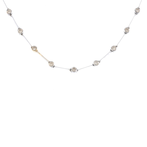 203 - A diamond necklace. Designed as a series of brilliant-cut diamond collets, with knife-edge bar space...