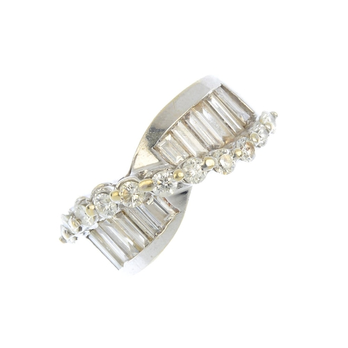 204 - A diamond dress ring. The brilliant-cut diamond scroll, set atop baguette-cut diamond asymmetric lin...