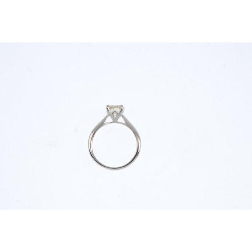 210 - An 18ct gold diamond single-stone ring. The brilliant-cut diamond, with tapered shoulders and polish...