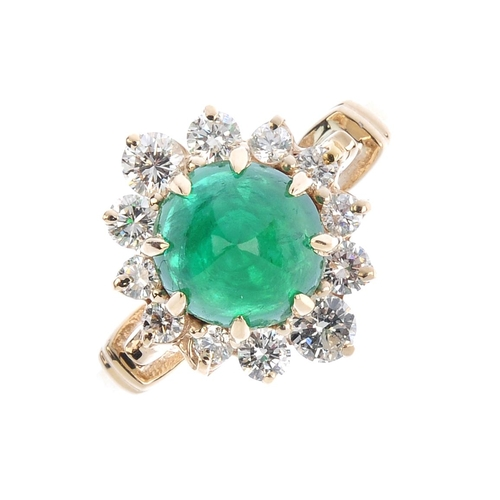 211 - An emerald and diamond cluster ring. The circular emerald cabochon, within a brilliant-cut diamond s...