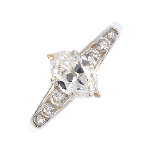 214 - A 9ct gold diamond single-stone ring. The marquise-shape diamond, with brilliant-cut diamond tapered...