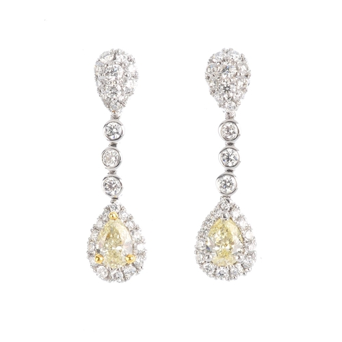 215 - A pair of 18ct gold diamond and coloured diamond earrings. Each designed as a pear-shape 'yellow' di...