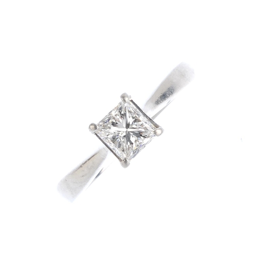 217 - A platinum diamond single-stone ring. The square-shape diamond, weighing 0.92ct, with tapered band. ...